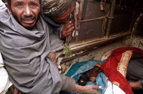 AFP photo of grieving father Afghanistan
